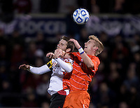 Patrick Mullins (15) of Maryland goes up for a header with Kyle Fisher (2) of Clemson during the ACC tournament semifinals at the Maryland SoccerPlex in Boyds, MD.  Maryland defeated Clemson, 1-0, in overtime.