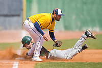 Third baseman Nick Rogers #9 of the North Carolina A&T Aggies tags out Justin Wilson #6 of the Charlotte 49ers as he tries to steal third base at War Memorial Stadium March 23, 2010, in Greensboro, North Carolina.  Photo by Brian Westerholt / Four Seam Images