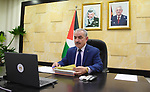 Palestinian Prime Minister Mohammad Ishtayeh, chairs the weekly meeting of his government, via a video link in the West Bank city of Ramallah, on March 9, 2021. Photo by Prime Minister Office