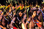 Altamira, Brazil. Kayapo warriors in a ceremonial dance. Altamira Gathering, 1989.