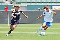 Christine Latham #7 of the Boston Breakers controls the ball past Ali Wagner #4 of the Los Angeles Sol during their WPS match at Home Depot Center on May 10, 2009 in Carson, California.