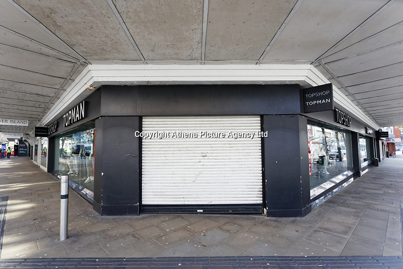 Pictured: The closed Next clothes store in Oxford Street in the deserted Swansea city centre, Wales, UK. Tuesday 24 March 2020<br /> Re: Covid-19 Coronavirus pandemic, UK.