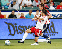 NY Red Bulls defender, Carlos Mendes(4) and Chivas USA forward, Justin Braun(17) battle for the ball during the 1st half. Chivas USA  took on the NY Red Bulls on June 28, 2008 at the Home Depot Center in Carson, CA. The game ended in a 1-1 tie.