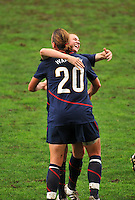 Heather O'Reilly congratulates Abby Wambach after her goal.  The USA captured the 2010 Algarve Cup title by defeating Germany 3-2, at Estadio Algarve on March 3, 2010.