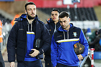 (L-R) Morgan Fox of and Jack Hunt of Sheffield Wednesday arrive prior to the game during The Emirates FA Cup Fifth Round Replay match between Swansea City and Sheffield Wednesday at the Liberty Stadium, Swansea, Wales, UK. Tuesday 27 February 2018