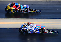 Sept. 14, 2012; Concord, NC, USA: NHRA pro stock motorcycle rider Shawn Gann (near lane) races alongside Scotty Pollacheck during qualifying for the O'Reilly Auto Parts Nationals at zMax Dragway. Mandatory Credit: Mark J. Rebilas-