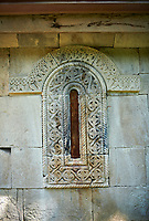 Pictures & Images of the Archangel Georgian Orthodox Church Georgian style exterior relief stone carvings of the apse, 10th - 11th century, Upper Krikhi, Krikhi, Georgia (country).<br /> <br /> For a small church Krikhi Archangel Church is extremely well decorated on the outside with Georgian style bas relief stonework. The south door has intricate carvings along its pillars and in the architraves above the door. The churches small windows are highly decorated with stone tracery around them.