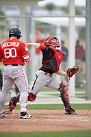 Catcher Victor Cerny (4) of the Canada Junior National Team throws down to second base as Jordan Procyshen (80) bats during an exhibition game against a Boston Red Sox minor league team on March 31, 2017 at JetBlue Park in Fort Myers, Florida.  (Mike Janes/Four Seam Images)