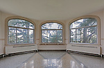 Empty room in turret with windows and marble floor, circa 1927.  Dating to 1927, the Masonic Retirement Center, locally known as the Masonic Home, in Des Moines, Washington is now an elegant event center available for rental.  In the historic Zenith neighborhood of the city of Des Moines. Please conact douglasorton@comcast.net regarding licensing of this image.