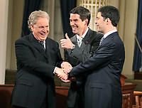 Quebec City, March 13, 2007 ? Jean Charest, Mario Dumont and AndrÈ Boisclair shake hands before the debate at National Assembly March 13, 2007. Just two weeks before the March 26 election, the debate could be a turning point.<br /> <br /> PHOTO :  Francis Vachon - Agence Quebec Presse