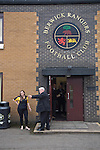 Berwick Rangers 5 East Stirlingshire 0, 23/08/2014. Shielfield Park, Scottish League Two. Two club officials in discussion outside the main entrance to Shielfield Park, before the Scottish League Two fixture between Berwick Rangers and East Stirlingshire. The home club occupied a unique position in Scottish football as they are based in Berwick-upon-Tweed, which lies a few miles inside England. Berwick won the match by 5-0, watched by a crowd of 509. Photo by Colin McPherson.
