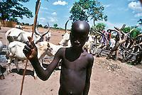 Rumbek / South Sudan.<br /> Tra i Dinka della regione del Bahr El Ghazal, pastori che vivono in lotta con la tribu di agricoltori Nuer. La mancanza di acqua, indispensabile per la vita di persone e animali è spesso motivo di tensioni tra i vari gruppi etnici. Nella foto un giovane pastore con la mandria di mucche.Among the Dinka of Bahr El Ghazal region, shepherds living in the struggle with the Nuer tribe of farmers. The lack of water, which is essential for the life of people and animals is often a cause of tensions between the various ethnic groups. In the picture a young shepherd with herd of cows.<br /> Photo Livio Senigalliesi