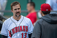 Lonnie Chisenhall (13) of the Indianapolis Indians talks with a teammate in the dugout at Victory Field on May 14, 2019 in Indianapolis, Indiana. The Indians defeated the RailRiders 4-2. (Andrew Woolley/Four Seam Images)