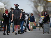 Patrons walk Saturday, April 3, 2021, while visiting the Fayetteville Farmers' Market on the Fayetteville downtown square. Fayetteville joins Rogers in continuing to require the wearing of masks in certain places despite the statewide mask mandate being lifted by Gov. Asa Hutchinson. Visit nwaonline.com/210404Daily/ for today's photo gallery. <br /> (NWA Democrat-Gazette/Andy Shupe)