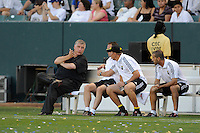 Columbus Crew Head Coach Sigi Schmid talks to coaches during a game against Los Angeles Galaxy in the first half at the Home Depot Center in Carson, CA on Saturday, June 21, 2008..