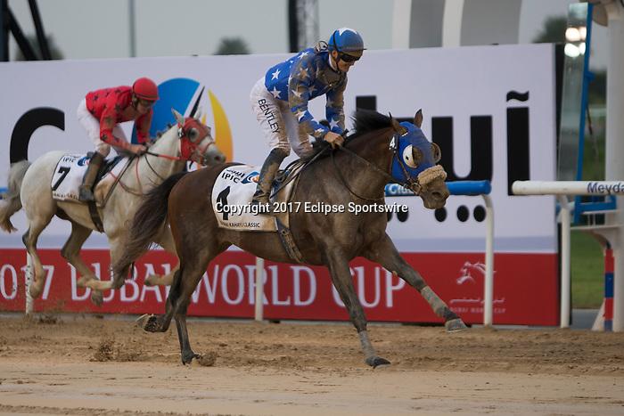 DUBAI,UNITED ARAB EMIRATES-MARCH 25: Reda,ridden by Harry Bentley,wins the Dubai Kahayla Classic at Meydan Racecourse on March 25,2017 in Dubai,United Arab Emirates (Photo by Kaz Ishida/Eclipse Sportswire/Getty Images)