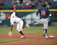Arkansas second baseman Robert Moore (1) reaches to catch the throw from third baseman Cullen Smith Thursday, April 1, 2021, as Auburn second baseman Brody Moore (19) during the fifth inning of play at Baum-Walker Stadium in Fayetteville. Visit nwaonline.com/210402Daily/ for today's photo gallery. <br /> (NWA Democrat-Gazette/Andy Shupe)