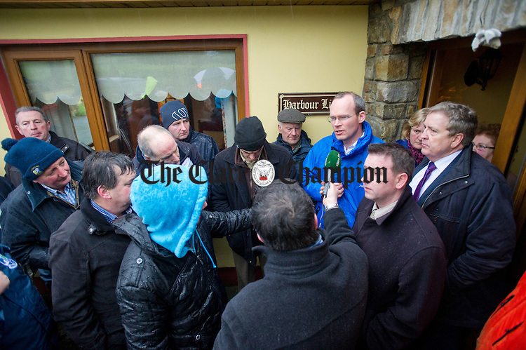 West Clare farmers and their representatives gather at Lacknashannagh Kildysart to hear the Minister for Agriculture, Food and the Marine, Simon Coveney address the storm damage issues during his visit to Clare. Photograph by John Kelly.