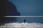Rowing, Woman rowing wilderness lake in single racing shell, Lake Whatcom, Bellingham area, Washington state, Gwen Howat,