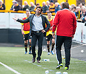 Alloa Manager Paul Hartley discusses a refereeing decision with Livingston manager Richie Burke.