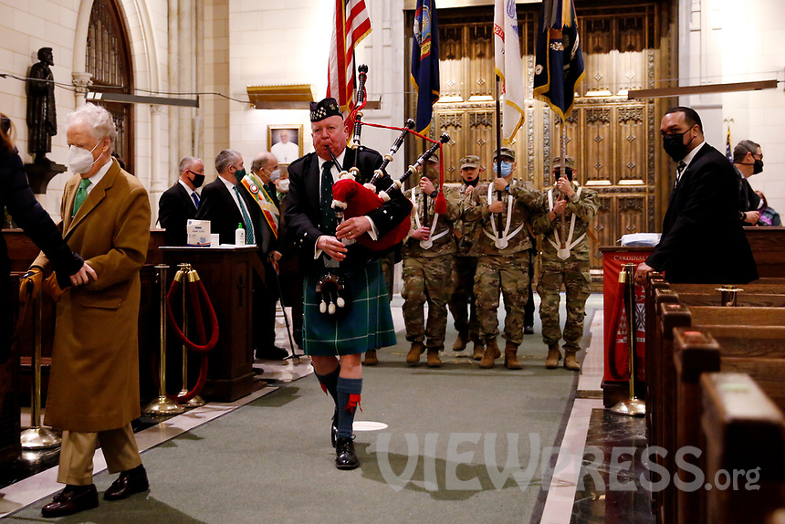NEW YORK, NEW YORK - MARCH 17: A pipe player enter to St. Patrick Cathedral before a mass during St. Patrick's Day on March 17, 2021 in New York. St. Patrick's Day Parade organizers say they postpone the celebration, but a small group marched to preserve the tradition. (Photo by John Smith/VIEWpress)