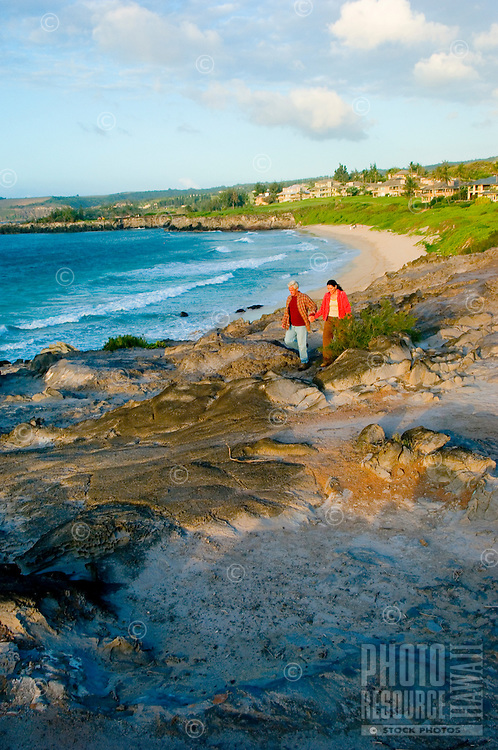 Romantic Couple Walk The Rugged Cliffs On Maui's North West Coast