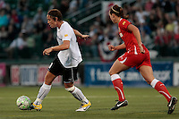 Abby Wambach of the magicJack, left and Whitney Engen (23) of the Western New York Flash during second half action. The Western New York Flash defeated the magicJack 3-0 in Women's Professional Soccer (WPS) at Sahlen's Stadium in Rochester, NY May 22, 2011.