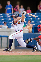 Chris Curley #25 of the Rome Braves follows through on his swing against the Greenville Drive at State Mutual Stadium July 25, 2010, in Rome, Georgia.  Photo by Brian Westerholt / Four Seam Images