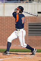 Tyler Cannon #10 of the Virginia Cavaliers follows through on his swing versus the East Carolina Pirates at Clark-LeClair Stadium on February 19, 2010 in Greenville, North Carolina.   Photo by Brian Westerholt / Four Seam Images