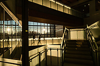 Low winter sun illuminates the staircases and skywalks in UAA's ConocoPhillips Integrated Science Building.
