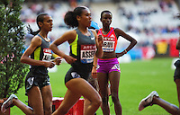 06 JUL 2012 - PARIS, FRA - Purity Kirui of Kenya watches the women's 3000m Steeplechase from the infield after being disqualified during the 2012 Meeting Areva in the Stade de France in Paris, France .(PHOTO (C) 2012 NIGEL FARROW)