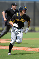 Pittsburgh Pirates infielder Trace Tam Sing (48) during an Instructional League game against the Tampa Bay Rays on September 27, 2014 at the Charlotte Sports Park in Port Charlotte, Florida.  (Mike Janes/Four Seam Images)