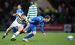 St Johnstone v Celtic...18.12.11   SPL .Chris Millar holds off Scott Brown.Picture by Graeme Hart..Copyright Perthshire Picture Agency.Tel: 01738 623350  Mobile: 07990 594431