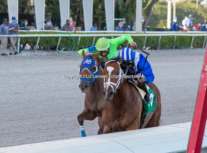 January 02, 2021:  #5 Mutasaabeq with jockey Luis Saez    on board, wins the Mucho Macho Man $100K Stakes at Gulfstream Park, On January 2nd, 2021,  in Hallandale Beach, Florida. Liz Lamont/Eclipse Sportswire/CSM