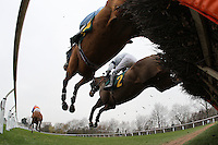 The field in jumping action during the North Norfolk Radio Selling Hurdle at Fakenham Racecourse, Norfolk - 16/03/12 - MANDATORY CREDIT: Gavin Ellis/TGSPHOTO - Self billing applies where appropriate - 0845 094 6026 - contact@tgsphoto.co.uk - NO UNPAID USE.