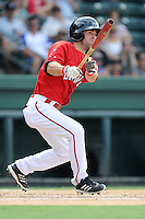 Right fielder Cole Sturgeon (35) of the Greenville Drive bats in a game against the Augusta GreenJackets on Sunday, July 13, 2014, at Fluor Field at the West End in Greenville, South Carolina. Sturgeon is a tenth-round pick of the Boston Red Sox in the 2014 First-Year Player Draft out of the University of Louisville. Greenville won, 8-5. (Tom Priddy/Four Seam Images)