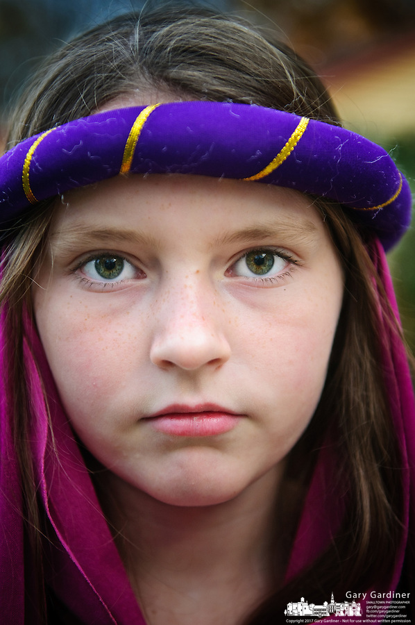 Young girl shows her Halloween costume. Photo Copyright Gary Gardiner.
