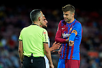 20th September 2021; Nou Camp, Barcelona, Spain; La Liga football league, FC Barcelona versus Granada CF;  Gerard Pique of FC Barcelona is spoken to by the referee during the Liga match between FC Barcelona and Granada CF .