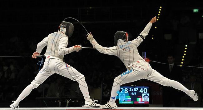 European Championships Fencing 2010 / Fecht Europameisterschaft 2010 in Leipzig - Competition Championat d'europe - im Bild:  mens foil team - the Italian  Andrea Baldini (right) against the Russian Alexey CHEREMISINOV (RUS) in finale  . Foto: Norman Rembarz..Norman Rembarz , Autorennummer 41043728 , Augustenstr. 2, 04317 Leipzig, Tel.: 01794887569, Hypovereinsbank: BLZ: 86020086, KN: 357889472, St.Nr.: 231/261/06432 - Jegliche kommerzielle Nutzung ist honorar- und mehrwertsteuerpflichtig! Persönlichkeitsrechte sind zu wahren. Es wird keine Haftung übernommen bei Verletzung von Rechten Dritter. Autoren-Nennung gem. §13 UrhGes. wird verlangt. Weitergabe an Dritte nur nach  vorheriger Absprache..