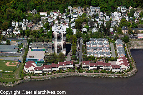 aerial photograph of Edgewater, Bergen County, New Jersey along Hudson river waterfront, in the view is the Hudson Harbour Condominiums and a portion of the Veterans Field Park