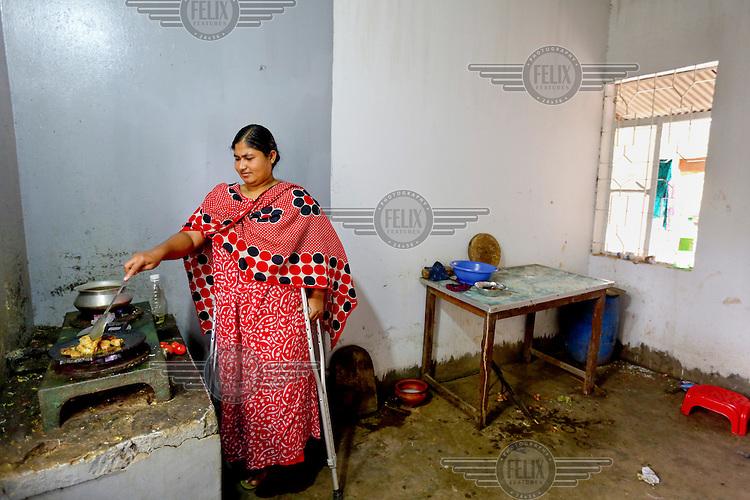 Rehana Akhter, a survivor of the 2013 Rana Plaza building collapse, who had a leg amputated after being rescued. She has spent six months in the CRP Hospital's hostel while undergoing continuous treatment. <br /> <br /> The eight storey Rana Plaza complex, which housed a number of shops and offices as well as five garment factories that employed more than 3,000 people, collapsed on 24 April 2013. When the search for bodies ended on 13 May 2013 the death toll had reached 1,129, a further 2,515 people were injured. The day before the collapse a structural engineer had warned the businesses inside to immediately evacuate the building. Many did, but the garment workers were told to return to work by the factory owners and the building's owner, Mohammed Sohel Rana, who is a member of the ruling Awami League's youth front. Afterwards some workers said they had been forced back to work with threats of violence and withholding of pay. A report produced by the Bangladeshi government stated that Sohel Rana illegally added several upper floors to the building which was not designed for the extra weight. Furthermore the huge generators installed on the upper floors, needed to power the factories, shook the entire structure and when they were started on the morning of the disaster it was their vibrations that triggered the collapse. 32 brands sourced clothes from the Rana Plaza but only half of those have contributed to a compensation fund and of those that have only Primark have made a significant payment.