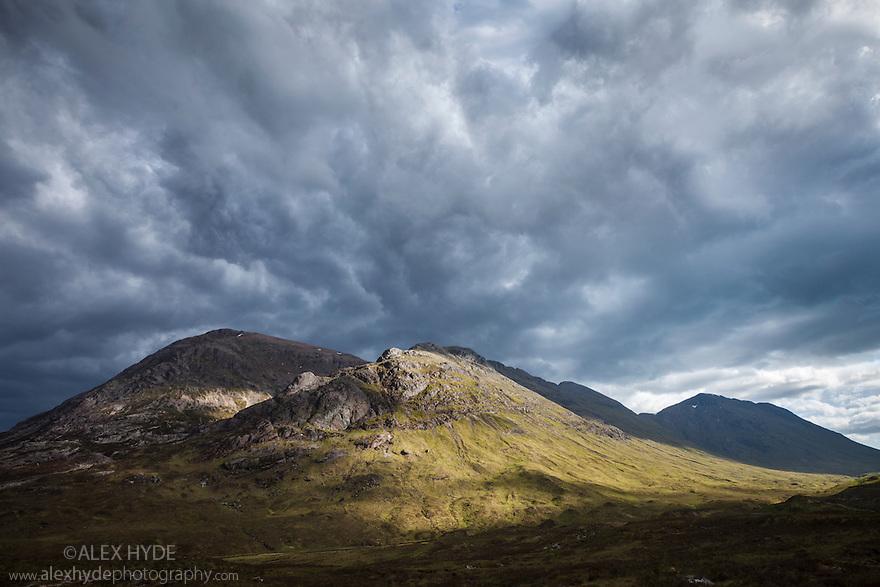 Storm clouds over Stob Dearg, the highest peak of Buachaille Etive Mor. Rannoch Moor, Scotland, UK. June.