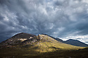 Storm clouds over Stob Dearg, the highest peak of Buachaille Etive Mor. Rannoch Moor, Scotland, UK. June.