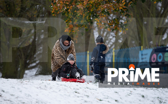 Mum gives her son a push while sledging in the park in Sidcup as her other child looks on following Heavy Snowfall at Sidcup, Kent, England on the 8 February 2021. Photo by Alan Stanford.