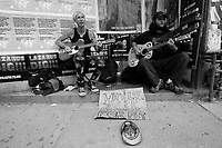 """Toronto (ON) CANADA,  April , 2008-..Street Musician playing (Social Distorsion's version of ) Johhny Cash """"Ring of Fire' on Queen street..."""