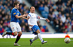 Rangers v St Johnstone....27.02.11 .Jody Morris appeals to his team amtes for more movement as he is closed down by David Healy.Picture by Graeme Hart..Copyright Perthshire Picture Agency.Tel: 01738 623350  Mobile: 07990 594431