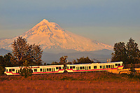 Max traveling to downtown Portland from Portland International Airport with Mt Hood in backkground