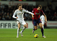 Sunday, 28 November 2012<br /> Pictured L-R: Michu of Swansea challenged by Gareth Mcauley of West Bromwich Albion<br /> Re: Barclays Premier League, Swansea City FC v West Bromwich Albion at the Liberty Stadium, south Wales.