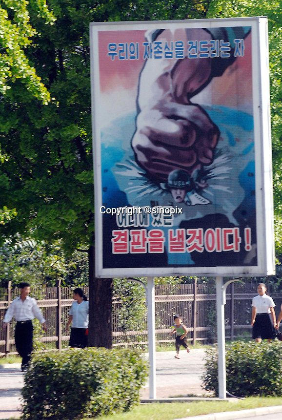 """Anti U.S. propoganda posters in Pyongyang, North Korea. The DPRK (Democratic People's Republic of Korea) is the last great dictatorship where the people are bombarded with images of the """"Eternal President"""" Kim Il-sung who died in 1994  and his son and current leader Kim Jong-il who are worshipped like a God.."""