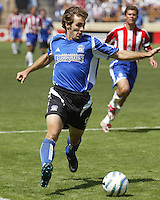San Jose's Brian Mullan prepares to cross the ball during a 2005 MLS game between the San Jose Earthquakes and Chivas USA on April 9, 2005 at Spartan Stadium in San Jose, California.  The game ended in a 3-3 tie.  Credit: JN Santos/ISI